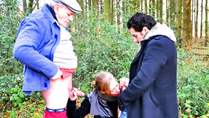 Horny chick decided to give a blowjob to two men in the woods