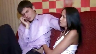 Kinky brunette sitting on this dude's lap trying to lure him