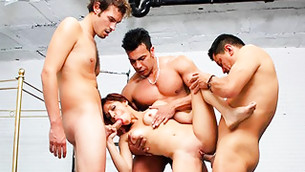 Three dudes are clenching this cutie babe's body in the pose to fuck her rocky