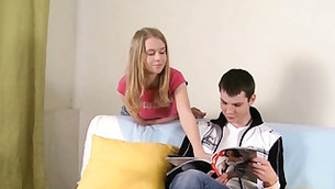 This honey is flirting with her boyfriend while he is reading a magazine