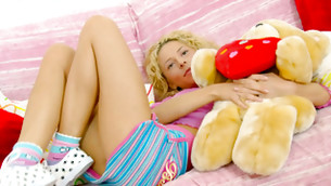 Scrumptious harlot is posturing in super short skirt and hugging her bear