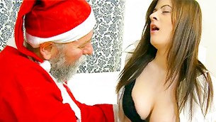 Fella in Santa's costume is looking at doe's bulky natural bumpers and she likes it